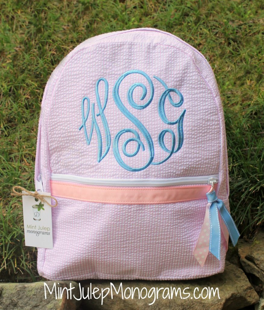 pink seersucker large backpack, baby blue thread, master circle font