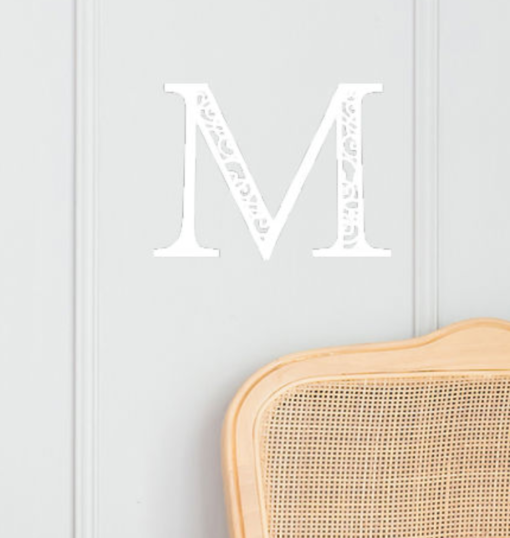 white wall sign with initial